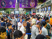 11 APRIL 2015 - BANGKOK, THAILAND:  People line up to buy tickets at Hua Lamphong train station in Bangkok. More than 130,000 passengers streamed through Bangkok's main train station Friday ahead of Songkran, Thailand's traditional new year celebration. Songkran will be celebrated April 13-15 but people started streaming out of Bangkok on April 10 to go back to their home provinces.    PHOTO BY JACK KURTZ