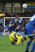 Paul Robinson defender for AFC Wimbledon (6) out jumps Billy Kee striker Accrington Stanley (29) during  the Sky Bet League 2 Play-Off first leg match between AFC Wimbledon and Accrington Stanley at the Cherry Red Records Stadium, Kingston, England on 14 May 2016. Photo by Stuart Butcher.
