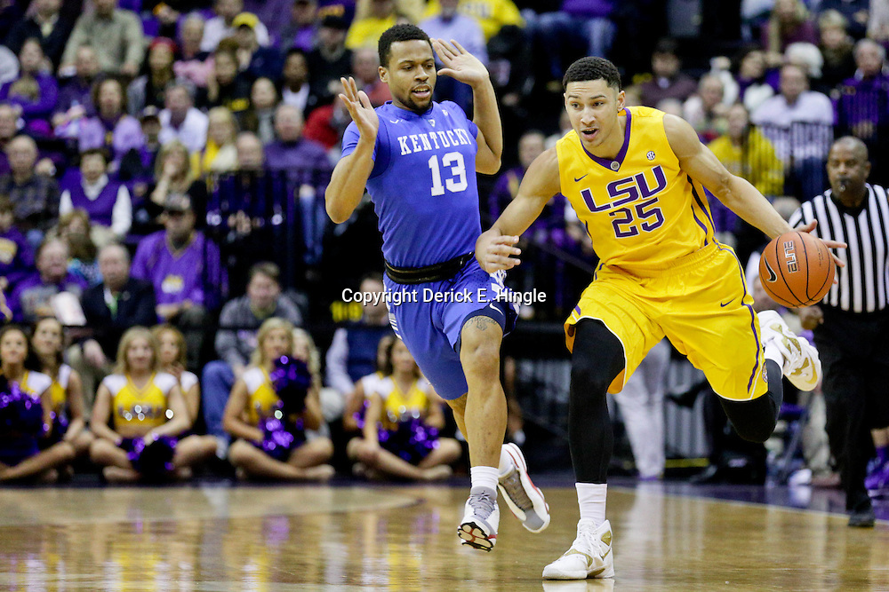 Jan 5, 2016; Baton Rouge, LA, USA; LSU Tigers forward Ben Simmons (25) drives past Kentucky Wildcats guard Isaiah Briscoe (13) during the first half of a game at the Pete Maravich Assembly Center. LSU defeated Kentucky 85-67. Mandatory Credit: Derick E. Hingle-USA TODAY Sports