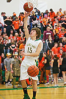 Rodney Dingman warms up with Lakeland High's varsity basketball team during the Prairie Pig basketball game Tuesday, Jan. 24, 2012 against Post Falls High in Rathdrum, Idaho.