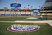 """LOS ANGELES, CA - APRIL 6:  The """"Opening Weekend"""" logo is painted on the grass in this general view photo of Dodger Stadium as the Los Angeles Dodgers take batting practice before the game against the San Francisco Giants at Dodger Stadium on Sunday, April 6, 2014 in Los Angeles, California. The Dodgers won the game 6-2. (Photo by Paul Spinelli/MLB Photos via Getty Images)"""