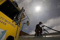 BERKELEY, CA - SEPTEMBER 2: Joshua Dibble fills up Ben Jordan's fuel truck with biodiesel fuel on September 2, 2005 in Berkeley, California. WIth gas prices rising and tax incentives motorists are starting to turn to alternative means to fuel their vehicles.  (Photograph by David Paul Morris)