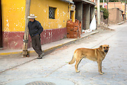 A man and dog are photographed in Chivay, Peru.