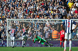 WEST BROMWICH, ENGLAND - Saturday, August 18, 2012: Liverpool's goalkeeper Jose Reina cannot prevent West Bromwich Albion's Peter Odemwingie scores the second goal from a second penalty during the opening Premiership match of the season at the Hawthorns. (Pic by David Rawcliffe/Propaganda)