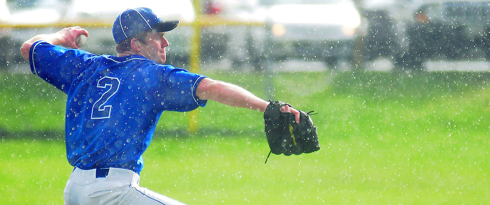 May 8, 2009 -- BATH, Maine. Mike Walton pitches the ball towards the plate in the middle of a mid-afternoon shower, as the forecasted rain clouds opened up. Despite playing under a rainbow, Morse lost to Leavitt 7-4 at home on Friday afternoon.  Photo by Roger S. Duncan.