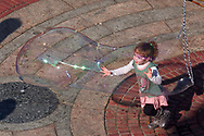 Child with bubbles at Bethesda Terrace in Central Park, New York City