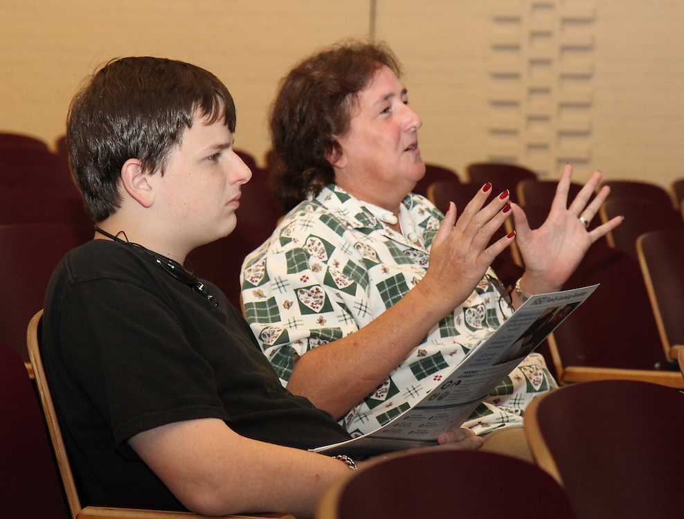 Community members hear about the construction process for a new Furr High School during a community meeting on Thursday, September 25, 2014.