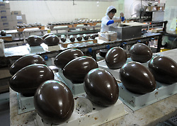A worker makes chocolate Easter eggs before the upcoming Easter at the company of Chocolate Arrufat in Buenos Aires, capital of Argentina, on March 27, 2013. According to local press, the company processed 12,000 kilos of chocolate this season., March 27, 2013. Photo by Imago / i-Images...UK ONLY.