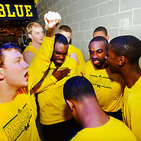 ANN ARBOR, MICHIGAN -- February 5, 2013 -- The University of Michigan basketball team pumps themselves up in the hallway on game day against rival Ohio State University in Ann Arbor, Michigan.  The Wolverines won 76-74 in overtime.   (PHOTO / CHIP LITHERLAND)