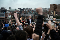 © Licensed to London News Pictures. 05/06/2017. Newcastle Upon Tyne, UK.  Jeremy Corbyn MP, Leader of the Labour Party, addresses a crowd of hundreds of his supporters who waited in the rain to hear him speak outside the Sage in Gateshead, England. Mr Corbyn spent one of the final days of the campaign trail in the Labour heartlands of North-East England before voters go to the polls in the UK General Election on June 8th 2017. Photo credit: MARY TURNER/LNP