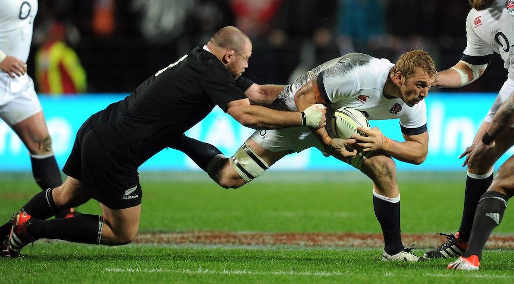 England's Chris Robshaw, right, is held by New Zealand's Tony Woodcock in the third International Rugby Test at Waikato Stadium, Hamilton, New Zealand, Saturday, June 21, 2014. Credit:SNPA / Ross Setford