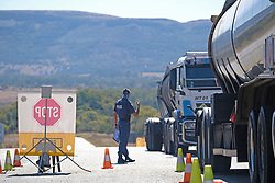 NORTH WEST SOUTH AFRICA - MAY 18: A general view of a national road block on the border of Northwest and Gauteng Provinces on May 18, 2020, in North West Province, South Africa. As part of combating Covid19 South Africa implented nationwide road blocks. South African Police Services (SAPS) supported by Metro Police, Traffic Police, South African Army (SANDF) and various health officials, road block operations aim to determine adherence to COVID-19 regulations along with screening and testing in some areas. (Photo by Gallo Images/Dino Lloyd)