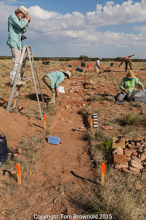"Richard Lang and students excavating the ""multi kiva site"" on state land"
