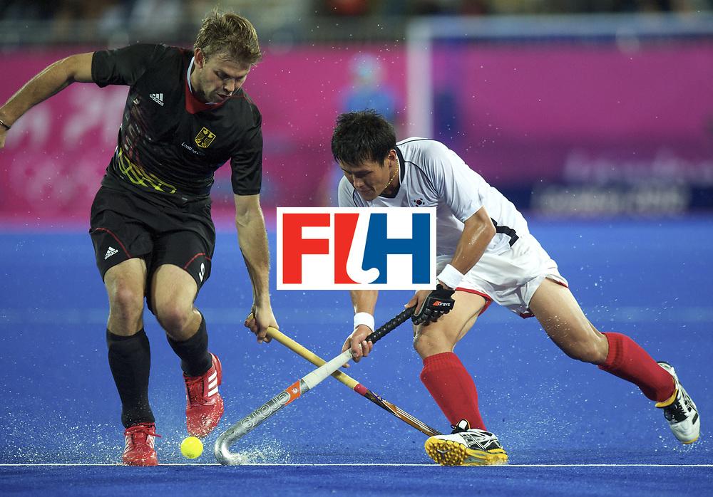 LONDON - Olympische Spelen 2012.Men match .Korea v Germany.foto: Moritz Furste  (L) Cha Jong Bok .FFU Press Agency COPYRIGHT FRANK UIJLENBROEK.