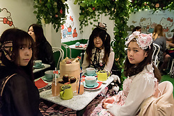 © Licensed to London News Pictures. 01/06/2016. London, UK. Customers dressed up in cosplay outfits on opening day. A pop up cafe has opened for the summer at Cutter & Squidge in Soho serving Hello Kitty's Secret Garden Afternoon Tea.  Natural, handmade products inspired by the Hello Kitty character popular worldwide, are on offer in Sanrio's first official Helly Kitty pop up cafe in Europe. Photo credit : Stephen Chung/LNP