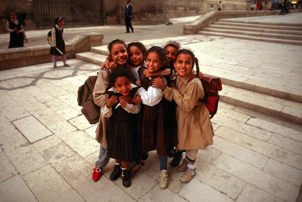 Egyptian girls playing near the el Rifa'i Mosque (Islamic Cairo), Cairo, Egypt
