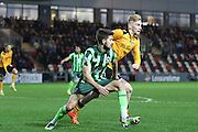 George Francomb of AFC Wimbledon and Olliver McBurnie  of Newport County during the Sky Bet League 2 match between Newport County and AFC Wimbledon at Rodney Parade, Newport, Wales on 19 December 2015. Photo by Stuart Butcher.
