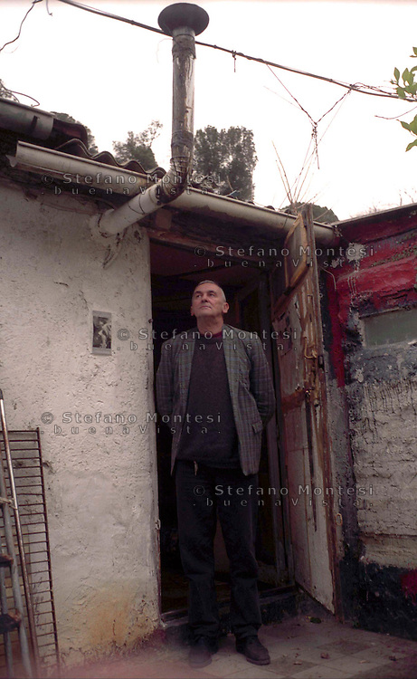 "Valentino Zeichen, is an Italian poet and writer. The last ""poet of Rome"" photographed in his abusive home (shack) of Borghetto Flaminio.Febraury, 2004 in Rome, Italy."