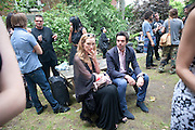 CLAIRE DE JONG; ELLIOT MACDONALD, Sebastian Horsley funeral. St. James's church. St. James. London afterwards in the church garden. July 1 2010. -DO NOT ARCHIVE-© Copyright Photograph by Dafydd Jones. 248 Clapham Rd. London SW9 0PZ. Tel 0207 820 0771. www.dafjones.com.