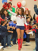 Houston Texans cheerleader Ashley S is greeted by students during the Houston launch of the Character Playbook, a joint initiative of the NFL and the United Way Worldwide at Pilgrim Academy, February 3, 2017.