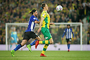 Norwich City defender Christoph Zimmermann (6)  runs away from Sheffield Wednesday midfielder George Boyd (21) during the EFL Sky Bet Championship match between Norwich City and Sheffield Wednesday at Carrow Road, Norwich, England on 19 April 2019.