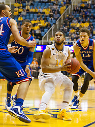 West Virginia Mountaineers guard Gary Browne (14) pulls up to shoot against the Kansas Jayhawks during the second half at the WVU Coliseum.