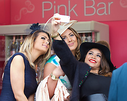 LIVERPOOL, ENGLAND - Friday, April 4, 2014: Racegoers taking a selfie during Ladies' Day on Day Two of the Aintree Grand National Festival at Aintree Racecourse. (Pic by David Rawcliffe/Propaganda)
