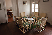 Chairs & table in a reception room of the parish priests house. Church of the Immaculate Conception. Port Louis.