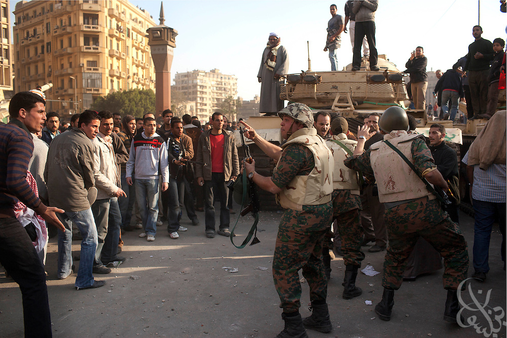 Anti-Mubarak protesters plead with a group of soldiers to protect them in Tahrir Square February 02, 2011in Cairo Egypt. Both anti and pro Mubarak  factions of protesters faced off today, battling for control of the square which has been at the center of more than a week of ongoing protests across Egypt..(Photo by Scott Nelson)