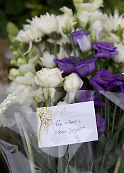© Licensed to London News Pictures. 02/04/2019. London, UK. A card attached to a floral tribute reads 'rest in peace never forgotten' on the road in Kentish Town, north London, where a man in his 20s was found with fatal stab wounds at 8.30 pm on 1st April.  Another man has been stabbed in Edmonton this morning. Photo credit: Peter Macdiarmid/LNP
