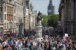 @Licensed to London News Pictures 13/07/2018. London, UK. View down Whitehall in Central London today as demonstrators march through the streets of Central London arriving at Trafalgar Square in protest to the US President Donald Trump' visit to the UK.Photo credit: Manu Palomeque/LNP