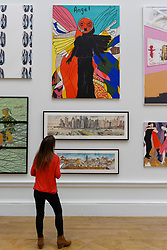 &copy; Licensed to London News Pictures. 08/06/2017. London, UK. A visitor views (top) &quot;Angel (Turquoise)&quot; by Yinka Shonibare RA.  Preview of the Summer Exhibition 2017 at the Royal Academy of Arts in Piccadilly.  Co-ordinated by Royal Academician Eileen Cooper, the 249th Summer Exhibition is the world's largest open submission exhibition with around 1,100 works on display by high profile and up and coming artists.<br />  Photo credit : Stephen Chung/LNP