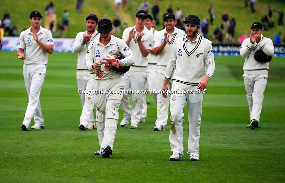 BJ Watling and Kane Williamson lead New Zealand off the field. Fourth day, second test, ANZ Cricket Test series, New Zealand Black Caps v Sri Lanka, 06 January 2015, Basin Reserve, Wellington, New Zealand. Photo: John Cowpland / www.photosport.co.nz