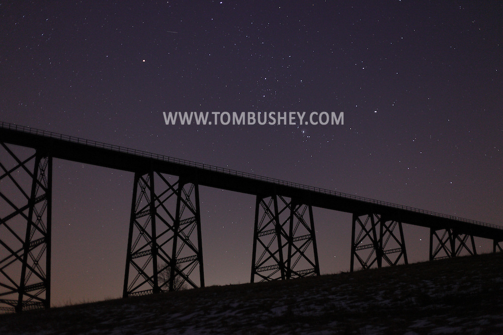 Salisbury Mills, NY - The constellation Orion rises over the Moodna Viaduct railroad bridge at twilight on Thursday, Jan. 14, 2010.