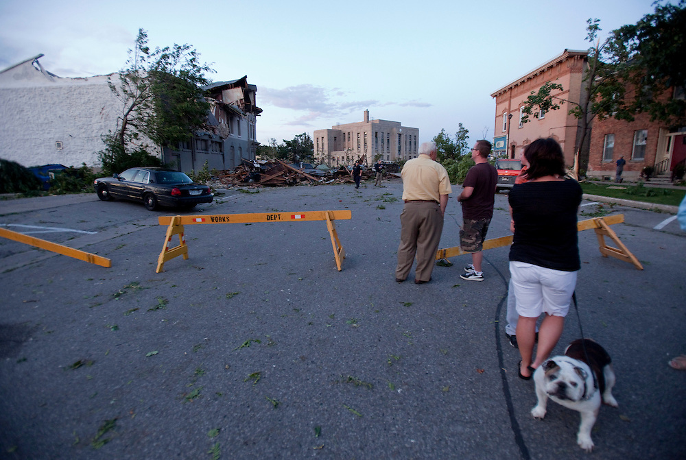 Residents survey the damage from a Tornado in Goderich Ontario, Sunday, August 21, 2011.<br /> THE CANADIAN PRESS/ Geoff Robins