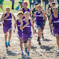 110114       Cable Hoover<br /> <br /> Miyamura Patriot Niles Thomas, center, leads his teammate off the starting line at the  district cross country meet at the Fox Run Golf Course in Gallup Saturday.
