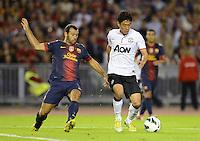 FUSSBALL  INTERNATIONAL Testspiel 2012/2013  08.08.2012 Manchester United  - FC Barcelona  Shinji Kagawa (re, Manchester United FC) gegen Javier Mascherano (Barca)
