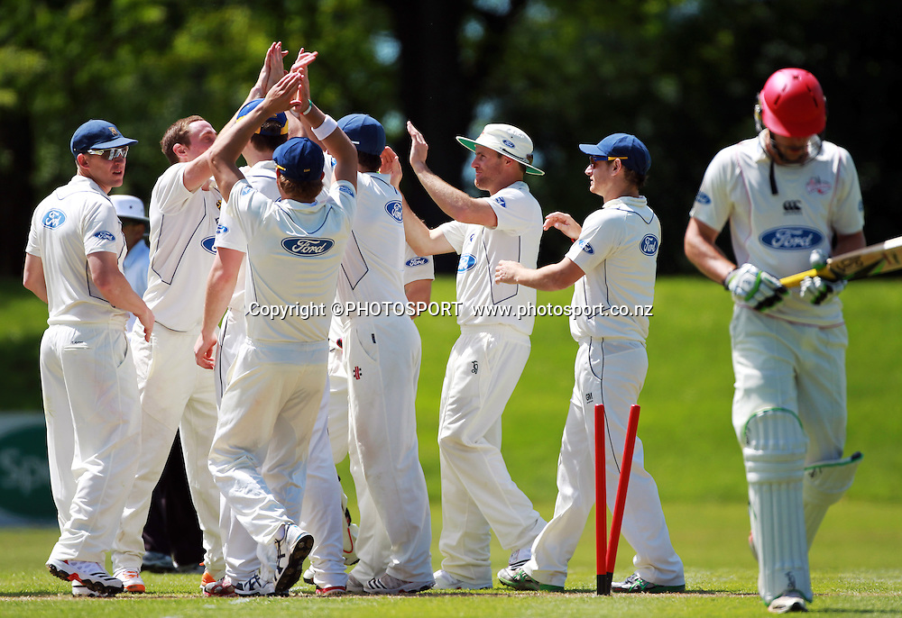 Otago players celebrate the wicket of Canterbury batsmen George Worker after James McMillan bowled him out. during play on the first day of the first game of the season. Canterbury Wizards v Otago Volts, Plunket Shield Game held at Mainpower Oval, Rangiora, Monday 07 November 2011. Photo : Joseph Johnson / photosport.co.nz