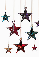 Christmas star ornaments on white background