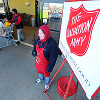 Angela Thomas stands outside the door at the Kroger at Crosstown in Tupelo ringing the bell for the Salvation Army on Tuesday.