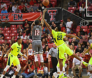 LUBBOCK, TX - DECEMBER 29: Keenan Evans #12 of the Texas Tech Red Raiders shoots the ball over King McClure #22 of the Baylor Bears during the game on December 29, 2017 at United Supermarket Arena in Lubbock, Texas. Texas Tech defeated Baylor 77-53. (Photo by John Weast/Getty Images) *** Local Caption *** Keenan Evans;King McClure