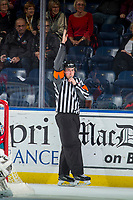 KELOWNA, CANADA - OCTOBER 27: Referee Ryan O'Keefe makes a call at the Kelowna Rockets against the Tri-City Americans on October 27, 2017 at Prospera Place in Kelowna, British Columbia, Canada.  (Photo by Marissa Baecker/Shoot the Breeze)  *** Local Caption ***