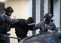 © Licensed to London News Pictures. 19/11/2018. London, UK. A man being detained by police during a raid by a CT-SFO (Counter Terrorist Specialist Firearms Officer) unit at a residential block of flats in Westminster, London. A number of men were detained at the scene. Photo credit: Ben Cawthra/LNP