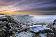 Scenic view of Curbar Edge at dawn in winter, Peak District, UK