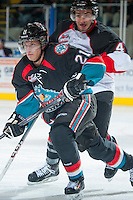 KELOWNA, CANADA - OCTOBER 19: Henrik Nyberg #21 of the Kelowna Rockets skates against the Prince George Cougars on October 19, 2013 at Prospera Place in Kelowna, British Columbia, Canada.   (Photo by Marissa Baecker/Shoot the Breeze)  ***  Local Caption  ***