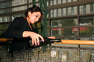 Maytal Levi of Centerville pours Poema Cava Brut sparkling wine during the Dayton Performing Arts Alliance Inaugural Gala at the Schuster Center in downtown Dayton, Saturday, October 5, 2013.