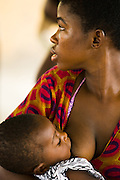 A woman breast feeds her child during an information session at the Kpong health center in Kpong, Ghana on Wednesday June 17, 2009.