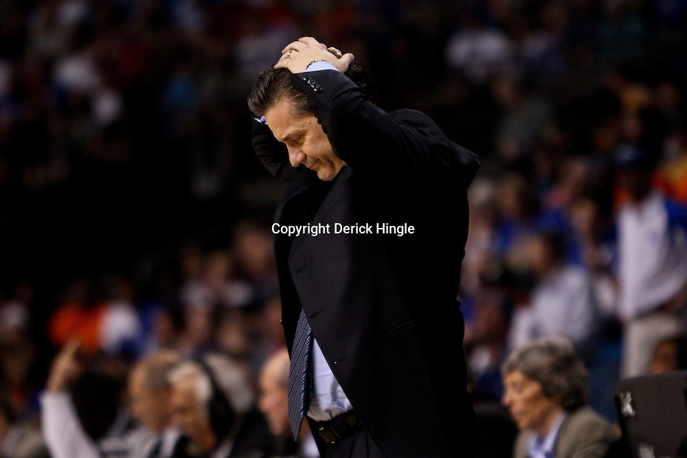 Mar 19, 2011; Tampa, FL, USA; Kentucky Wildcats head coach John Calipari during the first half of the third round of the 2011 NCAA men's basketball tournament against the West Virginia Mountaineers at the St. Pete Times Forum.  Mandatory Credit: Derick E. Hingle