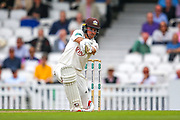 Rory Burns of Surrey hits the ball to the boundary for four runs during the Specsavers County Champ Div 1 match between Surrey County Cricket Club and Kent County Cricket Club at the Kia Oval, Kennington, United Kingdom on 7 July 2019.