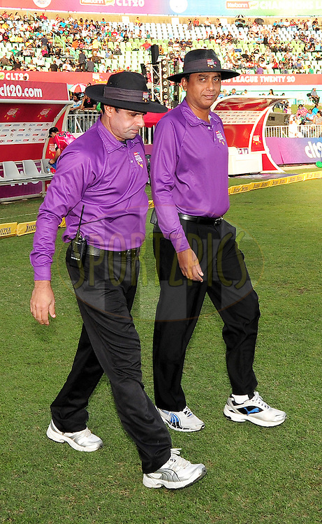 Empires walking on before match 18 of the Karbonn Smart CLT20 South Africa between The Sydney Sixers and The Mumbai Indians held at Kingsmead Park in Durban, South Africa on the 22nd October 2012..Photo by Gerhard Duraan/SPORTZPICS/CLT20